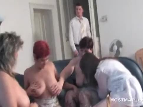 Matures masturbating and sucking cock in orgy