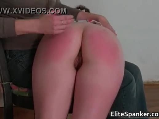 Sexy brunette gets her big butt spanked